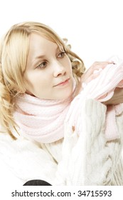Pretty young blonde woman in pink scarf looking aside