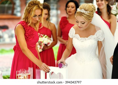 Pretty  young bridesmaids in bright pink dresses on the ceremony