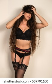 Pretty young brunette in black lingerie