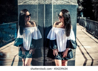 Pretty young brunette girl outdoor near building