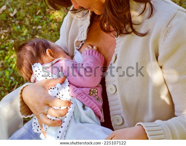 A pretty young brunette mum breastfeeding her baby