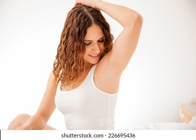 Pretty young brunette showing off her smooth and hair free armpits after hair removal