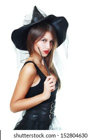 pretty young brunette witch, isolated against white background