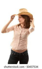 Pretty young brunette woman with cowboy hat