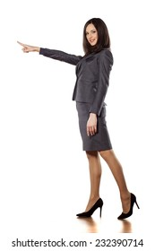 pretty young businesswoman pointing at empty space