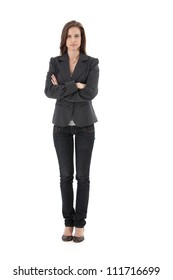 Pretty young businesswoman standing with arms folded, looking at camera, isolated on white, full length.