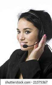 Pretty young call service representative against white