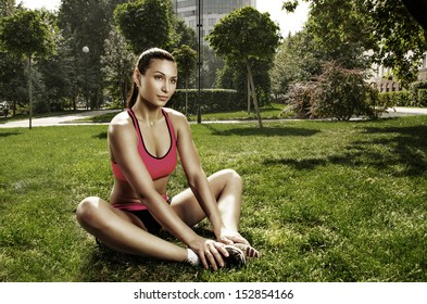 Pretty young caucasian woman training in the park
