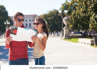 pretty young couple with city map at Padua streets, Italy