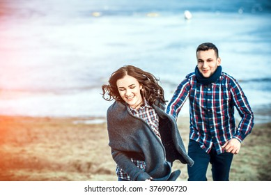 Pretty young couple have fun on the beach