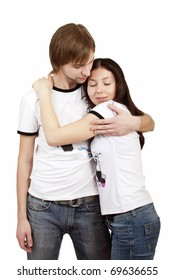 Pretty young couple tenderly embracing on a white background
