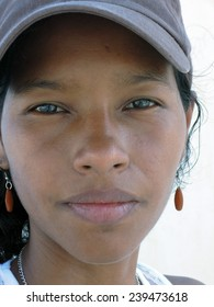 pretty young Creole Latina woman from Corn Island Nicaragua with serious look on face