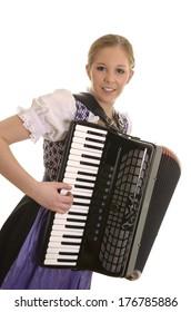 Pretty young dirndl woman playing accordion , Studio Shot