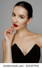 Pretty young fashion model with tan skin and red mat lips. Beauty shoot, natural makeup, fresh skin.