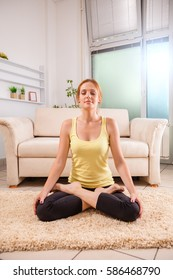 Pretty Young Female Doing Yoga At Home