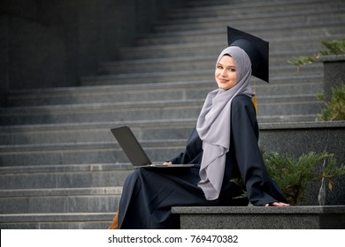 388bed93b8a Pretty young female graduate wearing hijab