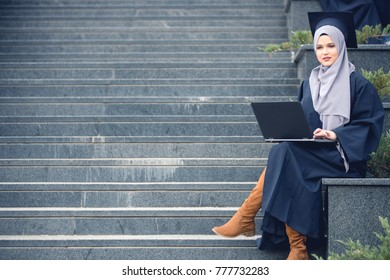 Pretty young female graduate wearing hijab