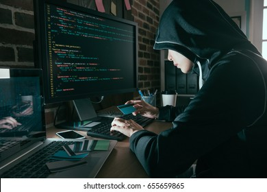 pretty young female hacker stolen credit card information and using personal account making trading through online data research.