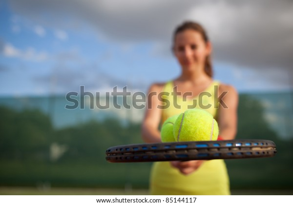 pretty, young female tennis player on the tennis court (shallow DOF, selective focus)