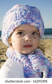 pretty young girl at the beach in winter