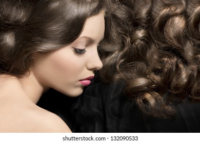 pretty young girl brunette in sweet portrait with hairstyle and curly hair