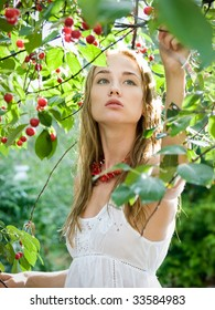 pretty young girl in cherry garden