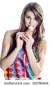 A pretty young girl eating an ice cream cone