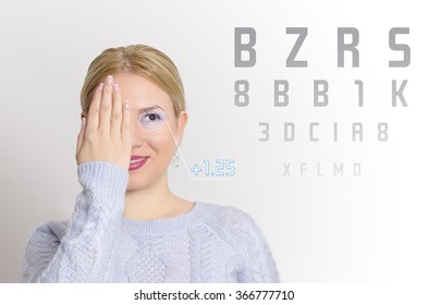 Pretty young girl examining her eyesight