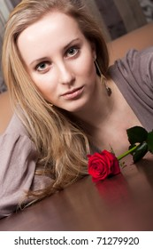 Pretty young girl with a flower