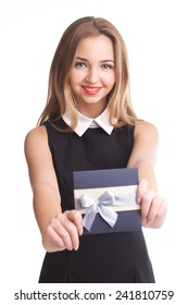 Pretty young girl holding envelope in studio isolated