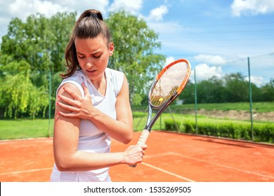 Pretty young girl injured during tennis practice, sport injuries