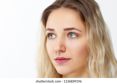 Pretty young girl  with make-up poses in studio, close up portrait