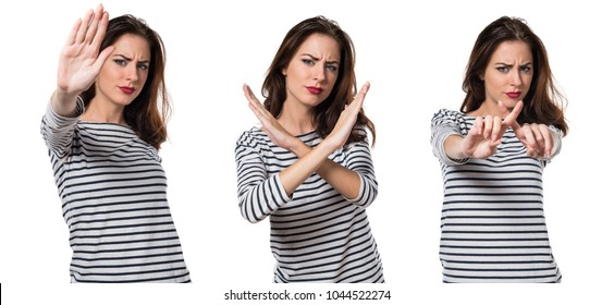 Pretty young girl making NO gesture