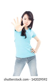 pretty young girl making stop hand sign, isolated on white background