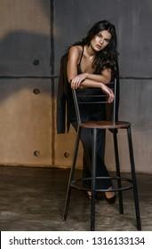 Pretty young girl in original loft interior