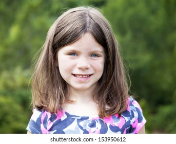 Pretty young girl portrait smiling outdoors