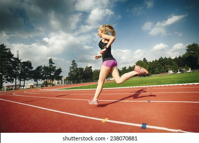 A pretty young girl running and stretching on the runway