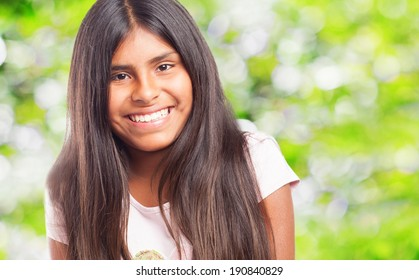 pretty young girl smiling with a positive gesture