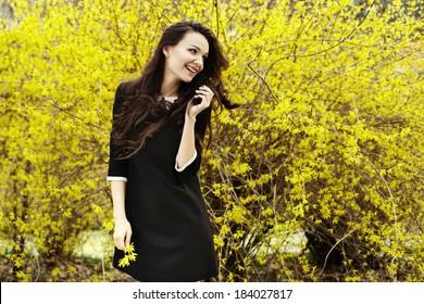 pretty young girl in spring garden
