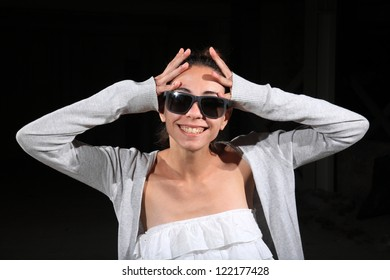 pretty young girl with sunglasses wearing a white dress