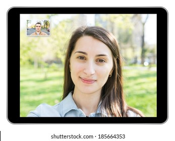 Pretty Young Girl Video Call With Young Man On Modern Tablet Similar To iPad