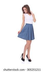 pretty young girl wearing blue short polka dot skirt