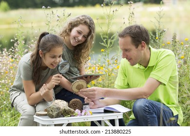 Pretty young girls having outdoor science lesson  exploring nature