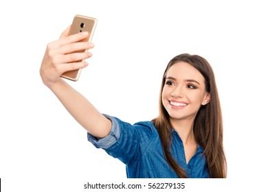 Pretty young happy woman making selfie on smartphone