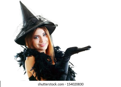 pretty young happy woman smiling and dressed as a fairy or witch for halloween party show open palm with copyspace