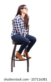Pretty young Hispanic woman wearing glasses and looking towards copy space