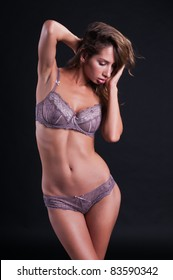 Pretty young Israeli woman in mauve lingerie