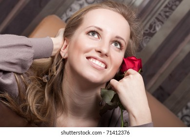 Pretty young lady with a flower