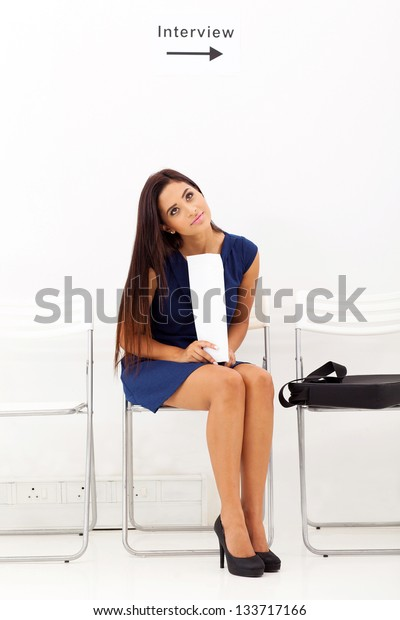 pretty young lady waiting for job interview
