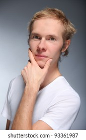 Pretty young man posing on light background